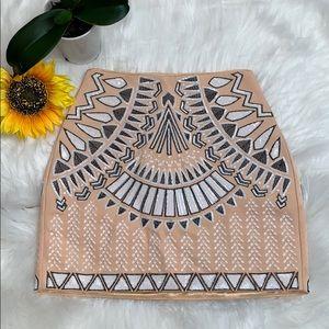 Bebe Embellished geometric mini skirt